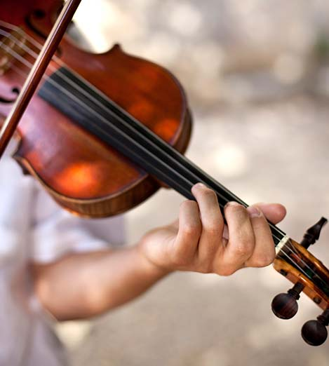 music education child playing violin